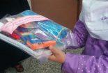 توزیع ۱۶۰۰ بسته نوشت افزاز و لباس مدرسه در بین دانش آموزان کنگان